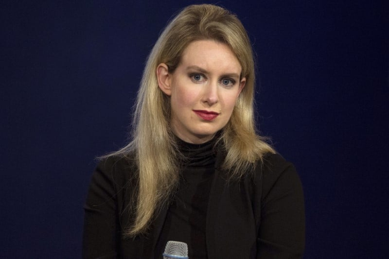 Theranos founder Holmes, former president indicted for fraud
