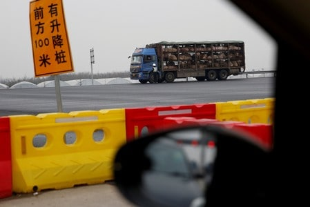 China finds African swine fever on four farms in single day