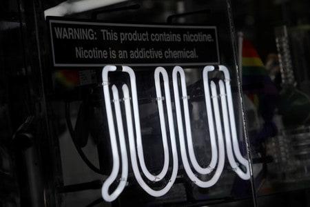 Juul hires Altria executive to handle regulation amid vaping crisis