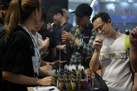 China's e-cigarette industry cuts 10% of staff, slows production as regulation tightens