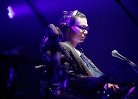 With high-tech glasses, Japanese ALS patient makes the beat go on
