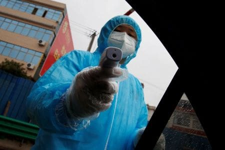 Chinese city accused of stealing virus masks from hard-hit neighbor