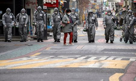 Thousands wait for hospital beds in South Korea as coronavirus cases surge