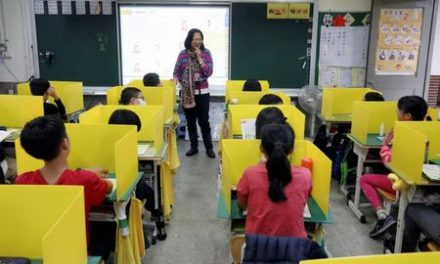 Taiwan school uses dividers during lunch to counter coronavirus