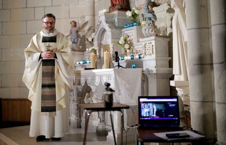 Locked-down French Catholics mark holy mass via YouTube