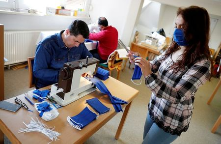 Refugees in eastern Germany sew coronavirus face masks for pensioners