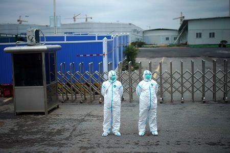 China's Wuhan city revises up total coronavirus death toll by 1,290