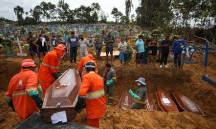Amazon city resorts to mass graves as Brazil COVID-19 deaths soar