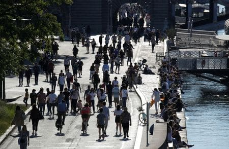 France reports fewer new coronavirus deaths, uptick in cases