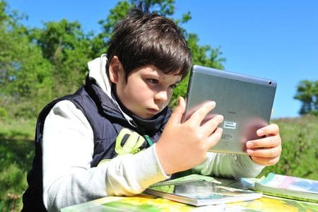 Italian boy travels a mile for internet signal to study under tree