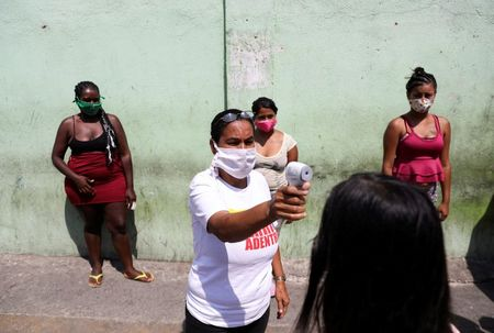 Venezuela tries harsher coronavirus quarantine measures in restless Caracas barrio