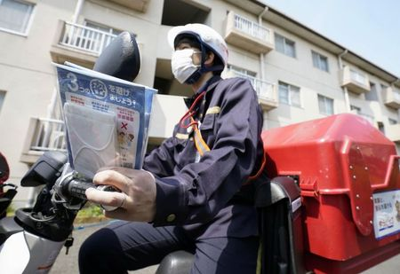 Japan's coronavirus mask handout tainted by gripes over mould, stains, insects